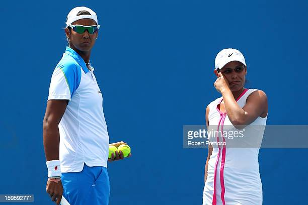 Stephanie Foretz Gacon of France talks tactics with Akgul Amanmuradova of Uzbekistan in their first round doubles match against Ekaterina Makarova of...