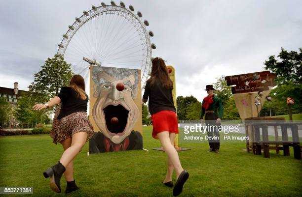 Stephanie Francis and Tansy Ratcliffe-James play the 'Jeremy Clarkson big mouth' game during a photo call for the London Dungeon's Carnivale side...