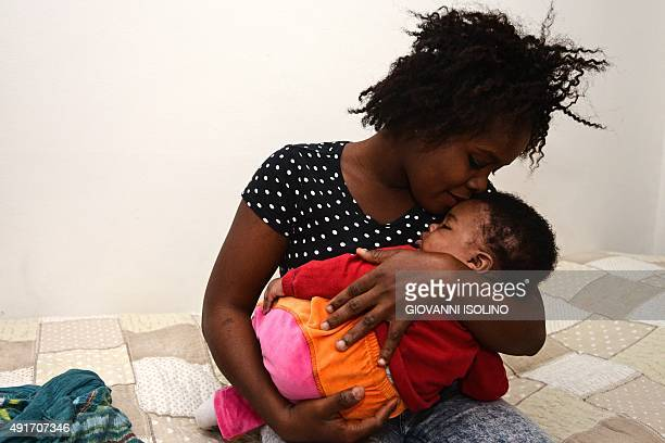 CARRIER Stephanie from Nigeria poses on October 1 2015 with her daughter Francesca Marina born on May 3 2015 during a rescue operation of the Italian...