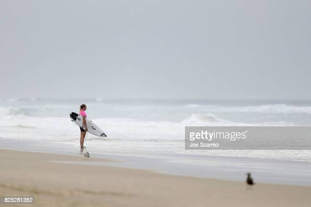 Stephanie Gilmore checks out the waves prior to her round 1 heat at the Vans US Open of Surfing on August 1 2017 in Huntington Beach California