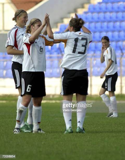 Stephanie Goddard of Germany celebrates with team mate Imke Wuebbenhorst after scoring the second goal during the UEFA Under 19 European Championship...