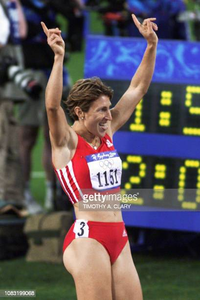 Stephanie Graf of Austria signals No1 after placing first in the women's 800m semifinal 2 on 23 September 2000 and qualifying for the finals to be...