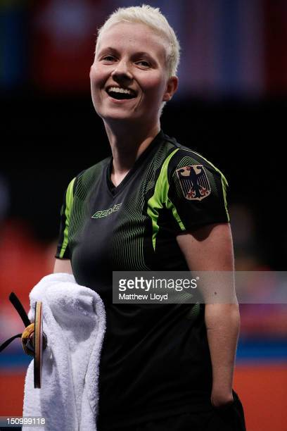 Stephanie Grebe of Germany reacts after winning her game against Yuliya Klymenko of Ukraine on day 1 of the Table Tennis tournament at the London...