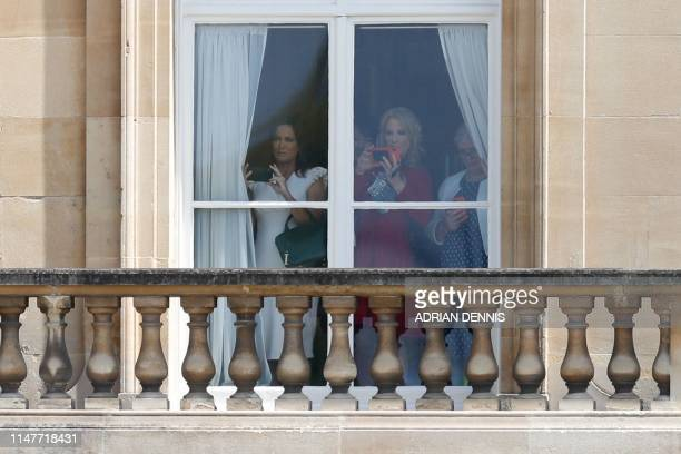 Stephanie Grisham Communications Director for the US First Lady and Kellyanne Conway Counselor to the US President watch from a balcony as the US...