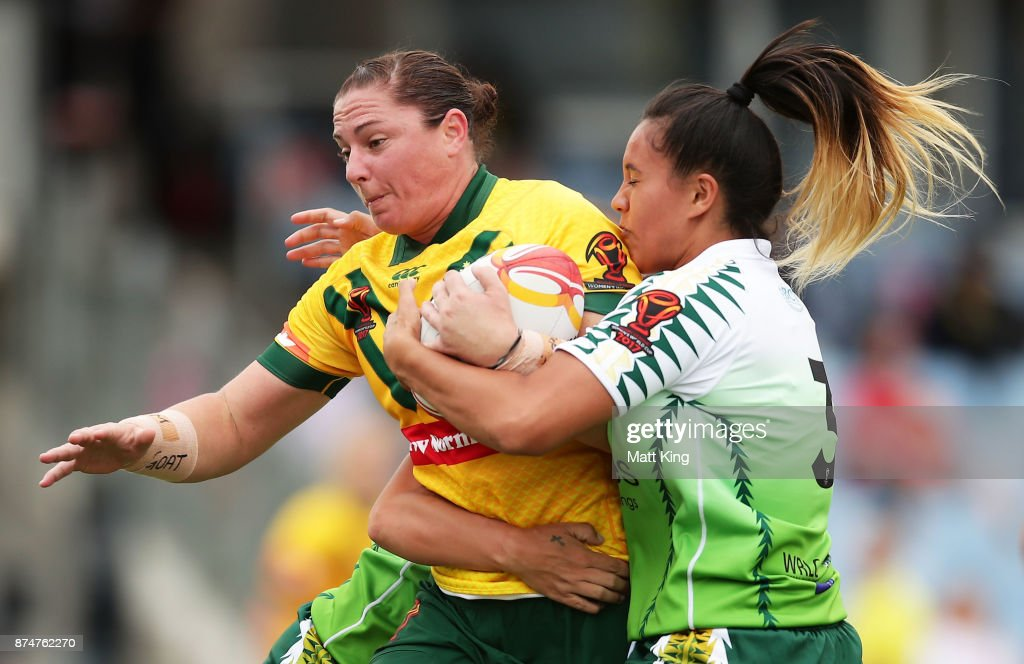 Stephanie Hancock of Australia is tackled during the 2017 Women's Rugby League World Cup match between Australia and Cook Islands at Southern Cross Group Stadium on November 16, 2017 in Sydney, Australia.