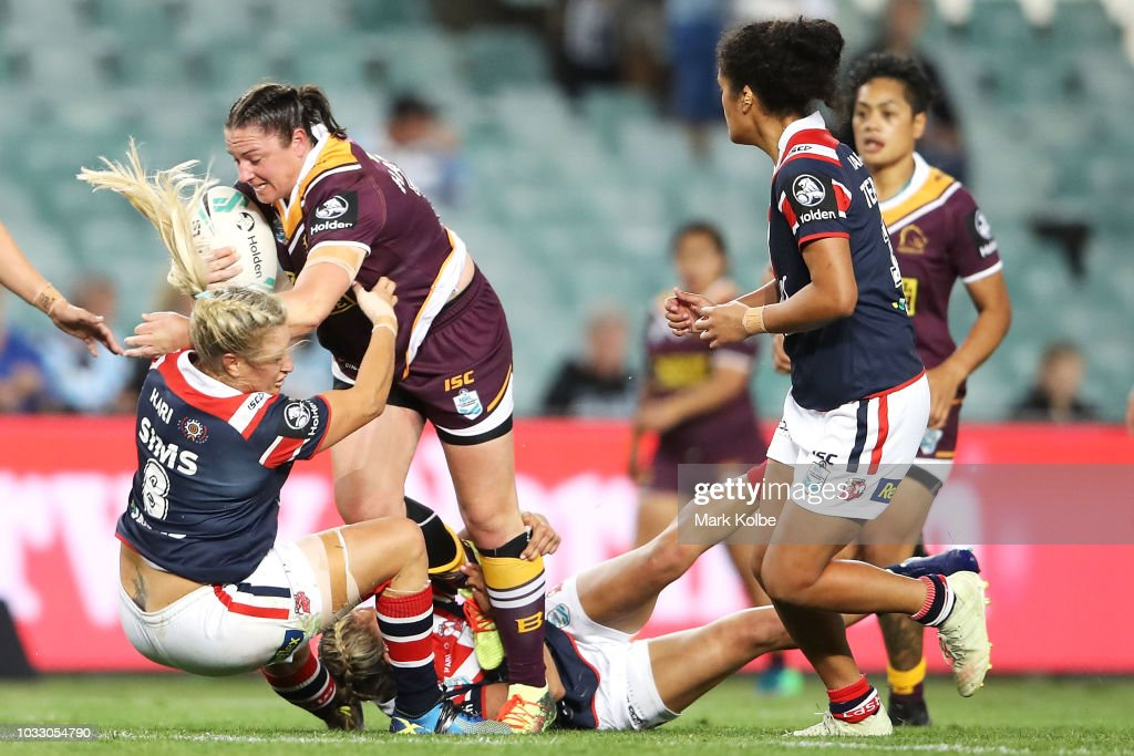 Stephanie Hancock of the Broncos is tackled by Ruan Sims of the Roosters during the round two Women's NRL match between the Sydney Roosters and the Brisbane Broncos at Allianz Stadium on September 14, 2018 in Sydney, Australia.