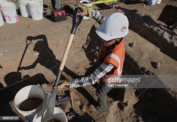 Stephanie Hernandez helps dig for artifacts from the early 19th century during an excavation at a railroad site near the San Gabriel Mission on...