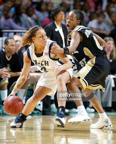 Stephanie Higgs looks to dribble past Cotelia Bond-Young during the first game of the 2004 ACC Women's Basketball Tournament, March 5, 2004.