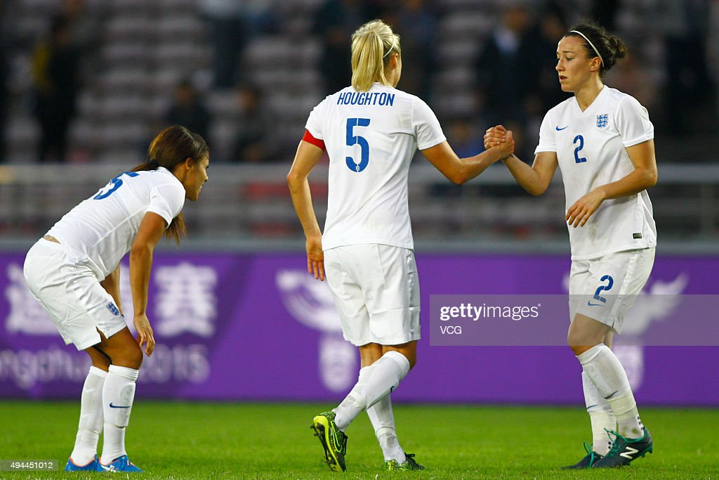 Stephanie Houghton #5 and Lucy Bronze #2 of England celebrate in the match between England and Australia during the 2015 Yongchuan Women's Football International Matches at Yongchuan Sports Center on October 27, 2015 in Yongchuan, Chongqing of China.