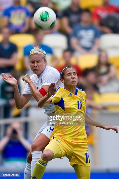 Stephanie Houghton of England fights for the ball with Tetyana Romanenko of Ukraine Women during the FIFA Women's World Cup 2015 Qualifier match...