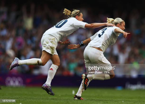 Stephanie Houghton of Great Britain celebrates with her team mate Kelly Smith after scoring her team's first goal during Women's Group E match...