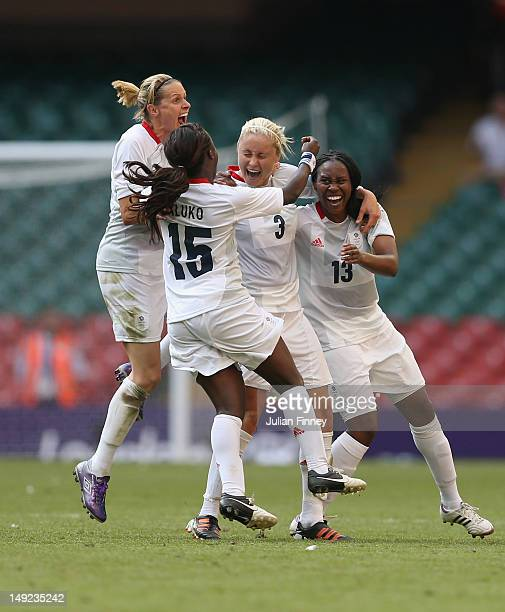 Stephanie Houghton of Great Britain is congratulated by team mates Kelly Smith of Great Britain Eniola Aluko of Great Britain and Ifeoma Dieke of...