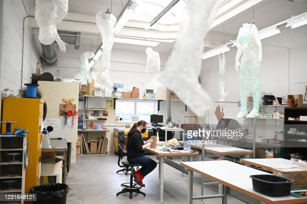 Stephanie Howard, a third year student studying model making for TV and film works in a workshop at the University of Bolton in Bolton, northwest...