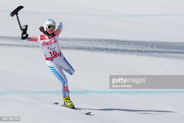 Stephanie Jallen of the United States celebrates after competing in the Women's Super Combined Standing Alpine Skiing event at Jeongseon Alpine...