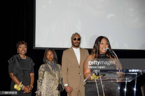 Stephanie Jester Londyn Wilburn Future and Tia WilburnAnderson on stage during the Golden Wishes Gala 2019 at Georgia Aquarium on November 16 2019 in...