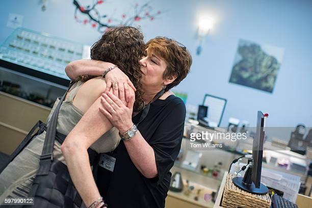 Stephanie Kahn right owner of Takoma Wellness Center in Takoma Park hugs customer Meredith Bower at the medical marijuana dispensary August 30 2016...