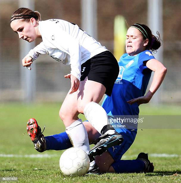 Stephanie Kaiser of Saarbruecken in action with Irmela Koch of Koeln during the Women's DFB Cup semi final match between TuS Koeln and 1. FC...