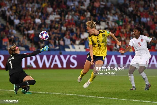 Stephanie Labbe of Canada saves from Magdalena Eriksson of Sweden during the 2019 FIFA Women's World Cup France Round Of 16 match between Sweden and...