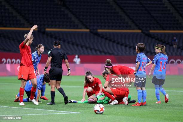 Stephanie Labbe of Team Canada goes down injured during the Women's First Round Group E match between Japan and Canada during the Tokyo 2020 Olympic...