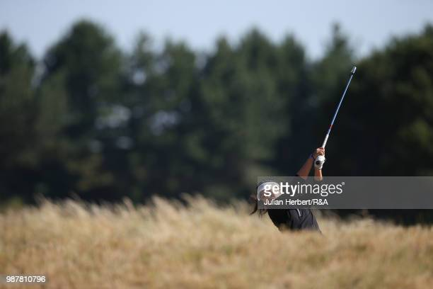 Stephanie Lau of The USA plays a shot during a semi final on day five of The Ladies' British Open Amateur Championship at Hillside Golf Club on June...
