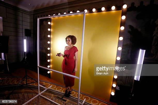 Stephanie Lee uses the GIF photobooth at the L'Oreal Paris Women of Worth Celebration 2016 on November 16 2016 in New York City