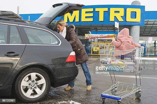 Stephanie Lieth loads her car with purchases at a Metro AG store in Neuss Germany on Tuesday Jan 12 2010 Metro AG Germany's largest retailer said...