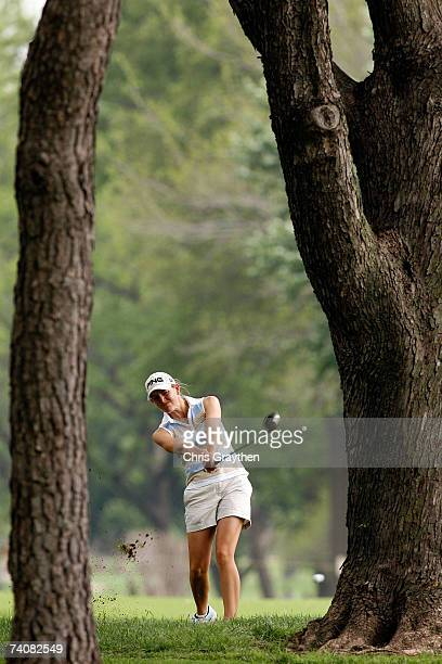 Stephanie Louden makes a shot through the trees on the 14th hole during the second round of the SemGroup Championship presented by John Q Hammons on...