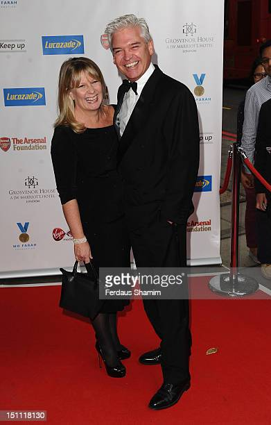 Stephanie Lowe and Phillip Schofield attend inaugural Mo Farah Foundation fundraising ball at Grosvenor House on September 1 2012 in London England