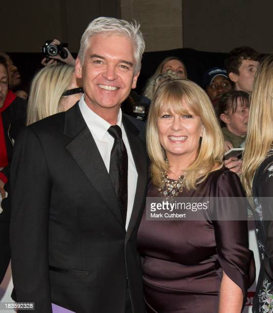 Stephanie Lowe and Phillip Schofield attend the Pride of Britain awards at Grosvenor House on October 7 2013 in London England