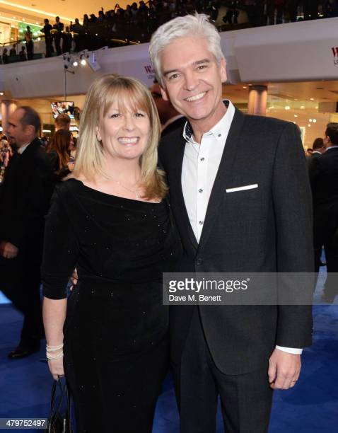 Stephanie Lowe and Phillip Schofield attend the UK Film Premiere of Captain America The Winter Soldier at Westfield London on March 20 2014 in London...