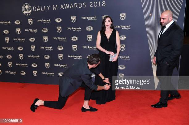 Stephanie Mannah is 'tweaked' by stylist Donny Gallela as husband Tim Mannah looks on as they attend the 2018 Dally M Awards on September 26 2018 in...