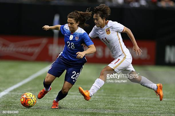 Stephanie McCaffrey of the United States drives the ball past Wang Shuang of China at MercedesBenz Superdome on December 16 2015 in New Orleans...