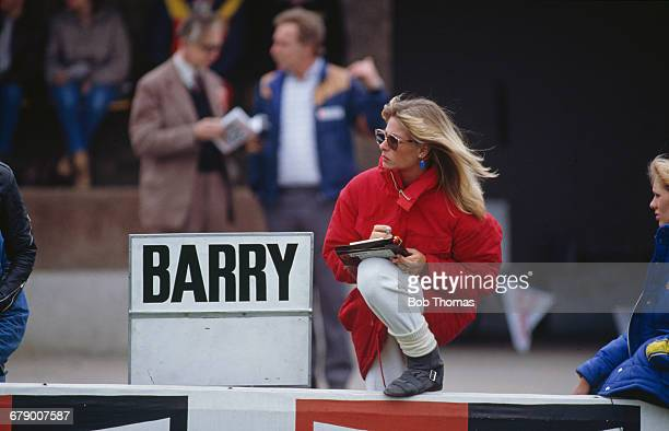 Stephanie McLean wife of British racing motorcyclist Barry Sheene next to a sign bearing her husband's name during the XIV TransAtlantic Challenge...