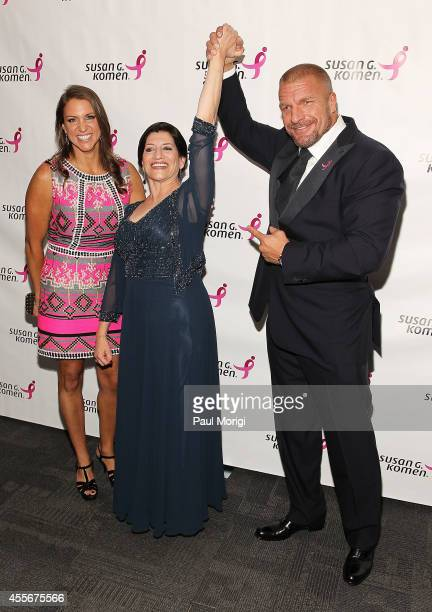Stephanie McMahon Chief Brand Officer WWE Dr Judy Salerno President CEO Susan G Komen and Paul Michael Levesque attend the 2014 Susan G Komen...