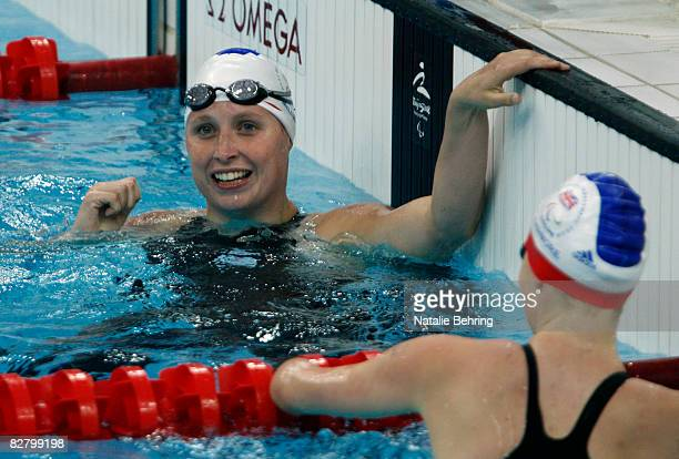 Stephanie Millward of Great Britain smiles after competing in the women's 100M backstroke S9 heat heat Swimming event at the National Aquatics Centre...