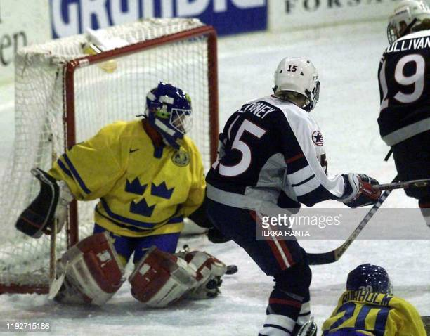 US Stephanie O'Sullivan scores the 03 lead for the US past Swedish goalie Lotta Gothesson while US Shelley Looney is looking on during their women's...