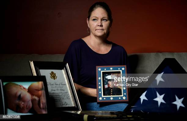 Stephanie Price holds a portrait of her son Jeromy Bubacz who had been fighting prescription drug addiction for years after doctors discovered he had...