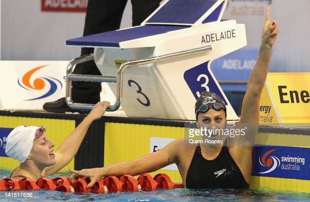 Stephanie Rice of Australia celebrates as Alicia Coutts catches her breath after the Final of the Women's 200 Metre Individual Medley during day four...