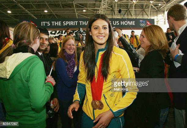 Stephanie Rice walks as the Australian Olympic team arrive home at Sydney Airport following the Beijing 2008 Olympics August 26 2008 in Sydney...