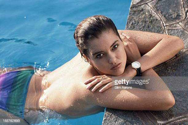 Stephanie Richardson leaning against the edge of a swimming pool on the island of Capri Italy in September 1989