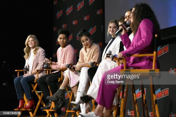 Stephanie Savage Rhenzy Feliz Lyrica Okano Virginia Gardner Gregg Sulkin Ariela Barer and Allegra Acosta speak onstage at the Marvel's Runaways panel...