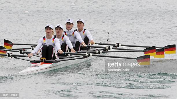 Stephanie Schiller, Carina Baer, Britta Oppelt and Tina Manker of Germany row in the women's quadruple sculls during the qualification heat of the...