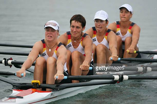 Stephanie Schiller, Kathrin Boron, Manuela Lutze and Britta Oppelt of Germany compete in the Women's Quadruple Sculls Heat 2 at the Shunyi Olympic...