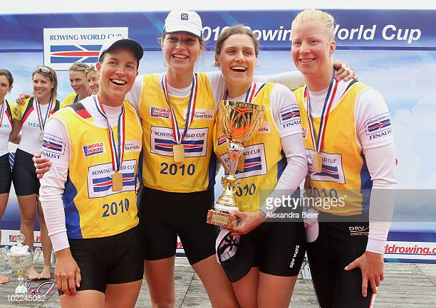 Stephanie Schiller, Tina Manker, Carina Baer and Britta Oppelt of Germany celebrate their first place of the women's quadruple sculls during the FISA...
