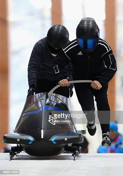 Stephanie Schneider and Anja Schneiderheinze of Germany practise a bobsleigh run ahead of the Sochi 2014 Winter Olympics at the Sanki Sliding Center...