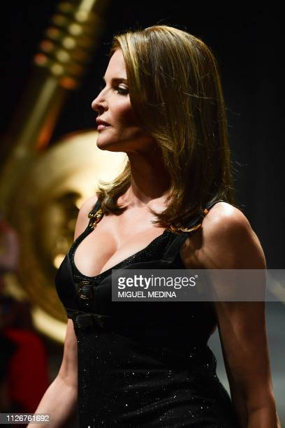 Stephanie Seymour presents a creation during the Versace women's Fall/Winter 2019/2020 collection fashion show on February 22 2019 in Milan