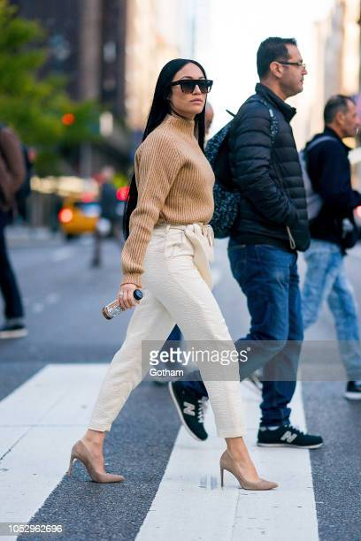 Stephanie Shepherd is seen wearing a Anine Bing sweater, Nanushka pants and Stuart Weitzman shoes with Celine sunglasses in Midtown on October 24,...