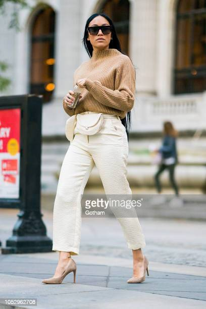 Stephanie Shepherd is seen wearing a Anine Bing sweater Nanushka pants and Stuart Weitzman shoes with Celine sunglasses in Midtown on October 24 2018...