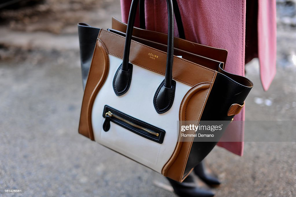 Stephanie Singer, Market Director, is seen wearing a Celine bag, at the Hood by Air show on February 10, 2013 in New York City.