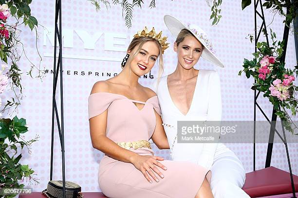 Stephanie Smith and Nikki Phillips pose at the Fashions On The Field Marquee on Crown Oaks Day at Flemington Racecourse on November 3 2016 in...